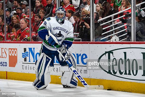 Goalie Ryan Miller of the Vancouver Canucks approaches the puck in the first period against the Chicago Blackhawks at the United Center on January 22...