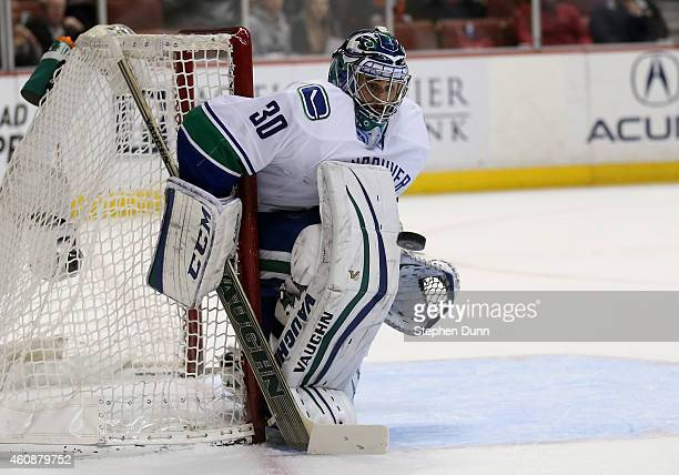 Goalie Ryan Miller of the Vancouver Canucks eyes the puck as it sails by against the Anaheim Ducks at Honda Center on December 28 2014 in Anaheim...