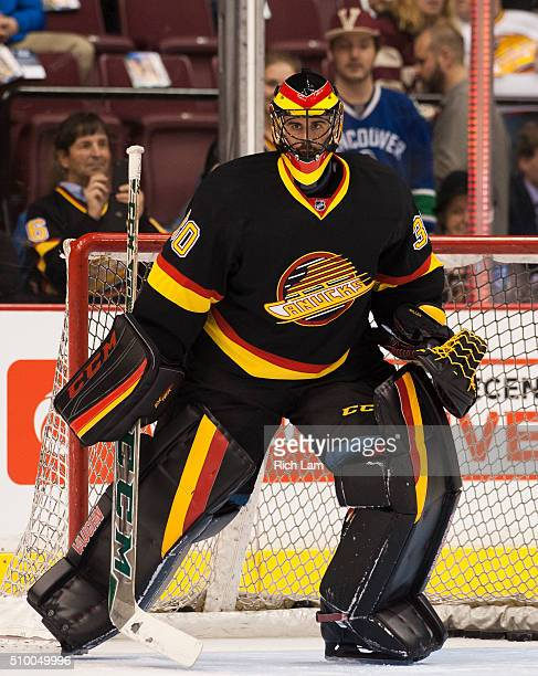 Goalie Ryan Miller of the Vancouver Canucks takes shots during the team warmup prior to NHL action against the Toronto Maple Leafs on February 2016...