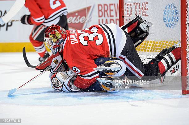 Goalie Scott Darling of the Chicago Blackhawks lays on top of Colin Wilson of the Nashville Predators after Wilson collided into him during Game...
