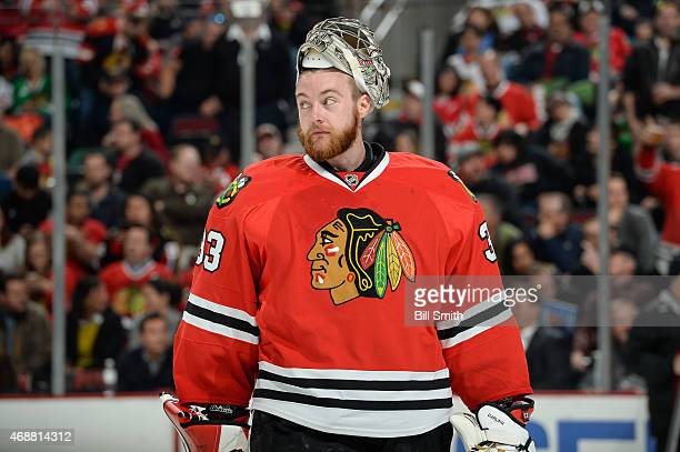 Goalie Scott Darling of the Chicago Blackhawks looks across the ice during the NHL game against the Los Angeles Kings at the United Center on March...