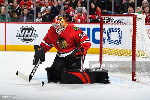 Goalie Scott Darling of the Chicago Blackhawks stops the puck in the second period against the Carolina Hurricanes at the United Center on January 6...