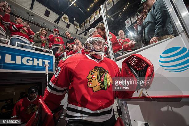 Goalie Scott Darling of the Chicago Blackhawks walks out to the ice prior to the game against the Los Angeles Kings at the United Center on October...