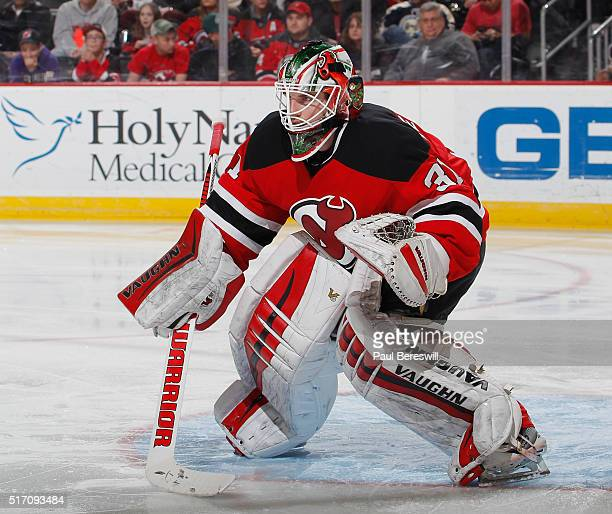 Goalie Scott Wedgewood of the New Jersey Devils defends his goal on his way to a victory against the Columbus Blue Jackets in his first NHL hockey...