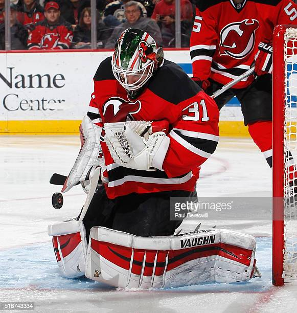 Goalie Scott Wedgewood of the New Jersey Devils makes a save in the third period on his way to a victory against the Columbus Blue Jackets in his...