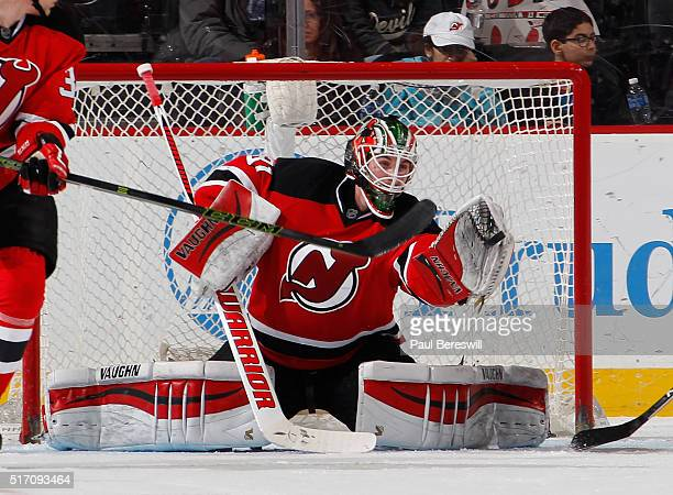 Goalie Scott Wedgewood of the New Jersey Devils makes a save on his way to a victory against the Columbus Blue Jackets in his first NHL hockey game...