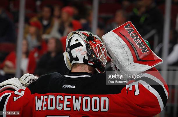 Goalie Scott Wedgewood of the New Jersey Devils playing in his first NHL game takes a break during a timeout against the Columbus Blue Jackets at...