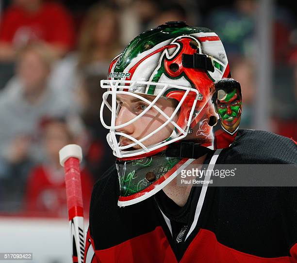Goalie Scott Wedgewood of the New Jersey Devils playing in his first NHL game waits for a faceoff against the Columbus Blue Jackets at Prudential...