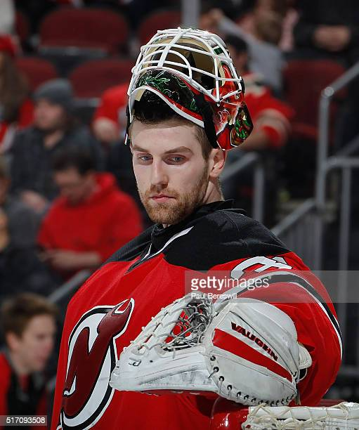 Goalie Scott Wedgewood of the New Jersey Devils playing in his first NHL game looks over during a timeout in the game against the Columbus Blue...