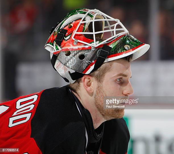 Goalie Scott Wedgewood of the New Jersey Devils playing in his first NHL game looks ahead during a timeout in the game against the Columbus Blue...