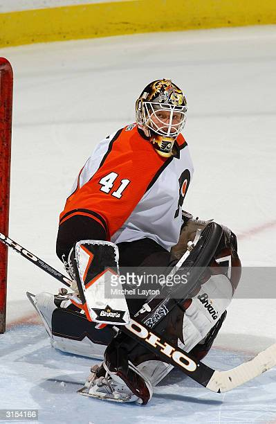 Goalie Sean Burke of the Philadelphia Flyers protects the net during the game against the Washington Capitals at the MCI Center on March 6, 2004 in...