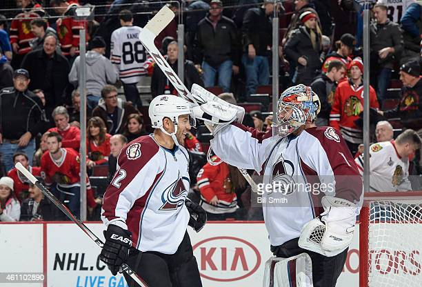 Goalie Semyon Varlamov and Jarome Iginla of the Colorado Avalanche celebrate after Varlamov shut out the Chicago Blackhawks 20 during the NHL game at...