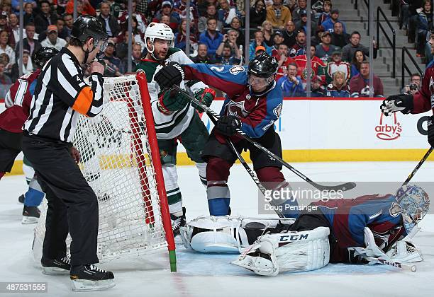 Goalie Semyon Varlamov of the Colorado Avalanche covers the puck as Nick Holden of the Colorado Avalanche defends the crease against Jason Pominville...