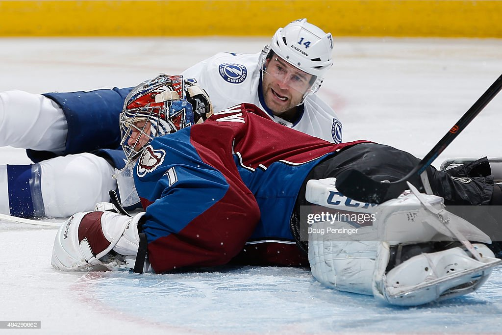 Goalie Semyon Varlamov #1 of the Colorado Avalanche covers the puck against Brett Connolly #14 of the Tampa Bay Lightning at Pepsi Center on February 22, 2015 in Denver, Colorado. The Avalanche defeated the Lightning 5-4.