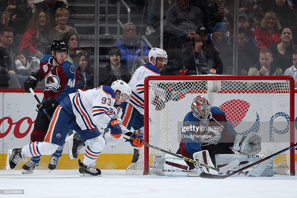 Goalie Semyon Varlamov #1 of the Colorado Avalanche defends the goal against Ryan Nugent-Hopkins #93 of the Edmonton Oilers at Pepsi Center on December 19, 2015 in Denver, Colorado. The Avalanche defeated the Oilers 5-1.