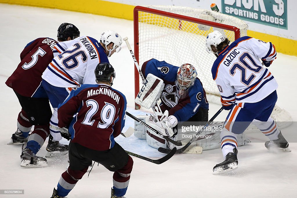 Goalie Semyon Varlamov #1 of the Colorado Avalanche gloves the puck as he makes a save against the Edmonton Oilers as Nate Guenin #5 and Nathan MacKinnon #29 of the Colorado Avalanche follow the action along with Iiro Pakarinen #26 and Luke Gazdic #20 of the Edmonton Oilers at Pepsi Center on December 19, 2015 in Denver, Colorado. The Avalanche defeated the Oilers 5-1.