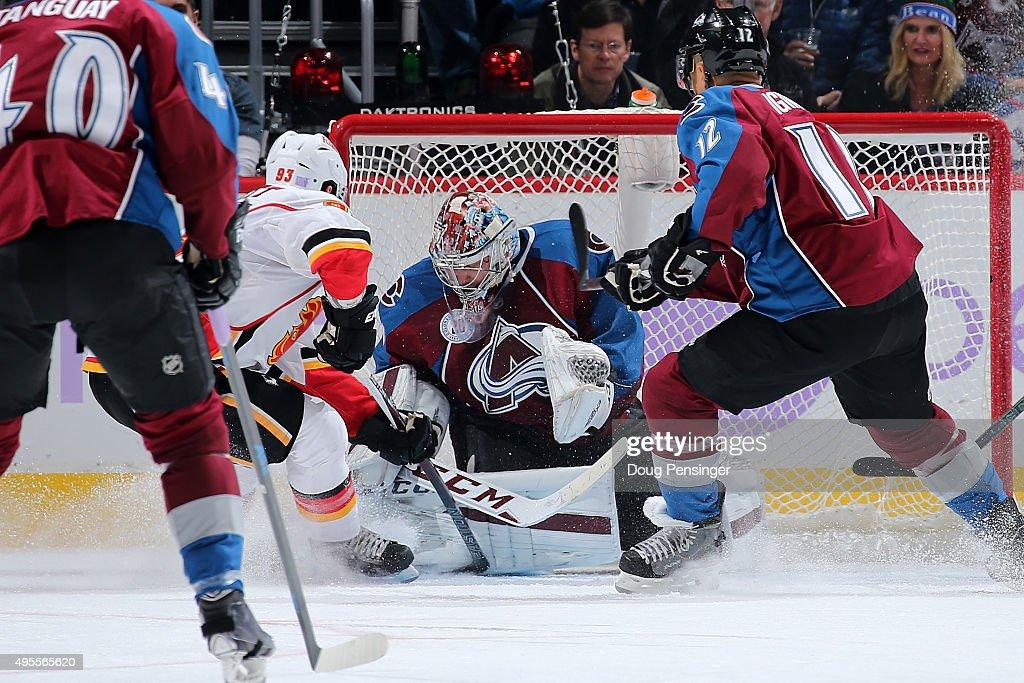 Goalie Semyon Varlamov #1 of the Colorado Avalanche makes a save against Sam Bennett #93 of the Calgary Flames at Pepsi Center on November 3, 2015 in Denver, Colorado. The Avalanche defeated the Flames 6-3.
