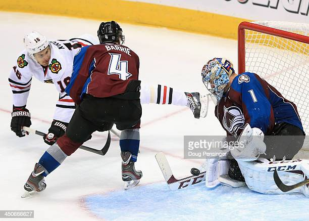 Goalie Semyon Varlamov of the Colorado Avalanche makes a save on a shot by Marcus Kruger of the Chicago Blackhawks as Tyson Barrie of the Colorado...