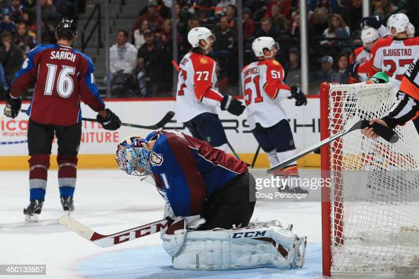 Goalie Semyon Varlamov of the Colorado Avalanche reacts as the Florida Panthers celebrate a goal by Jonathan Huberdeau of the Florida Panthers in the...