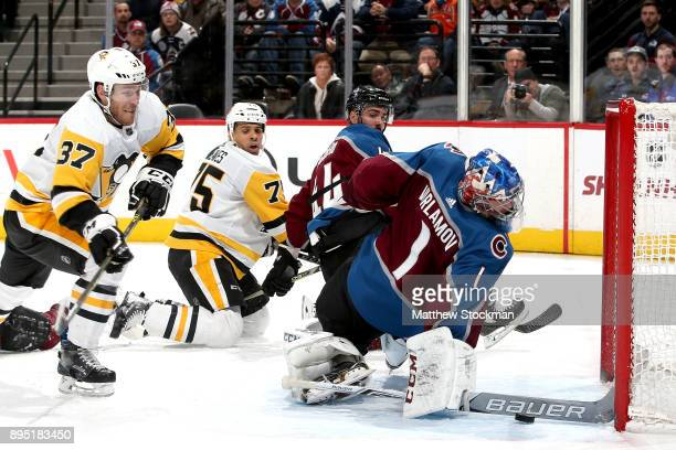 Goalie Semyon Varlamov of the Colorado Avalanche saves a shot on goal in the third period by Carter Rowney of the Pittsburgh Penguins at the Pepsi...