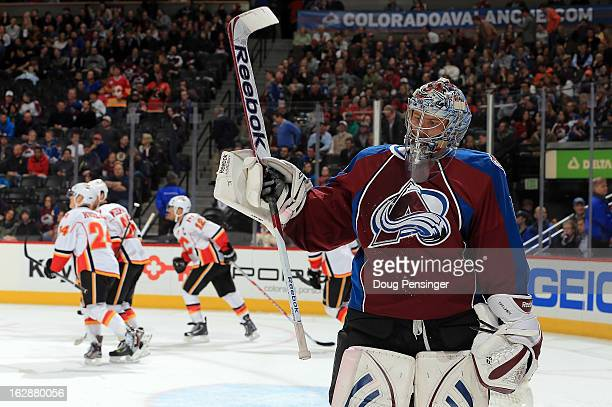 Goalie Semyon Varlamov of the Colorado Avalanche skates away from the goal as Jarome Iginla of the Calgary Flames celebrates his goal with his...