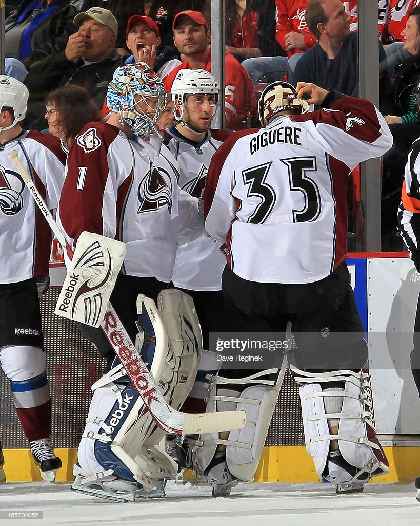 Goalie Semyon Varlamov #1 of the Colorado Avalanche talks with teamate Jean-Sebastien Giguere #35 after geting pulled from the game during a NHL game against the Detroit Red Wings at Joe Louis Arena on April 1, 2013 in Detroit, Michigan.