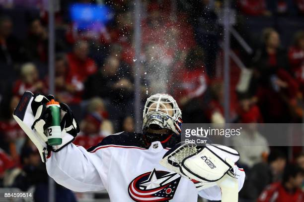 Goalie Sergei Bobrovsky of the Columbus Blue Jackets gets a drink before the start of the second period against the Washington Capitals at Capital...