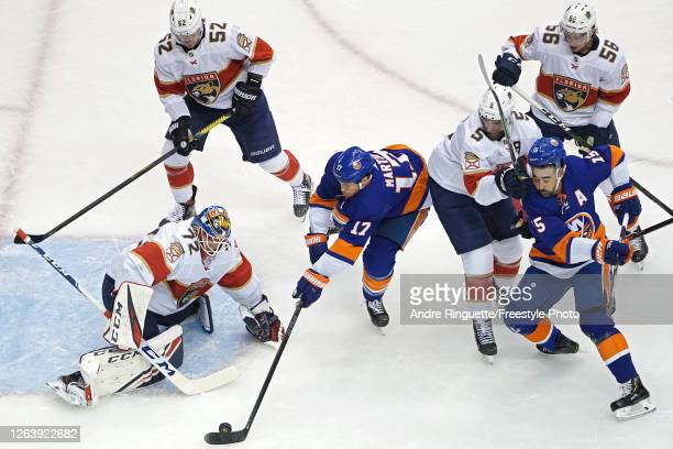 Goalie Sergei Bobrovsky of the Florida Panthers makes a save on Matt Martin of the New York Islanders during the first period in Game Two of the...