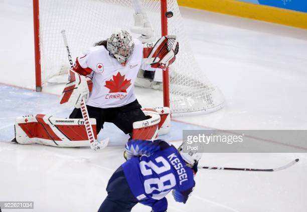 Goalie Shannon Szabados of Canada deflects a shot by Amanda Kessel of the United States during the second period of the women's gold medal hockey...