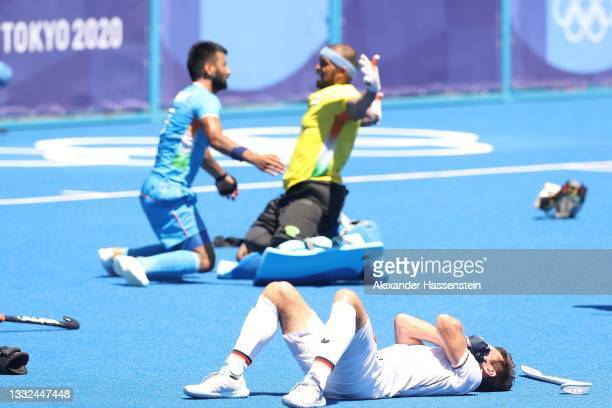 Goalie Sreejesh Parattu Raveendran of Team India celebrates after winning while Lukas Windfeder of Team Germany reacts following the Men's Bronze...