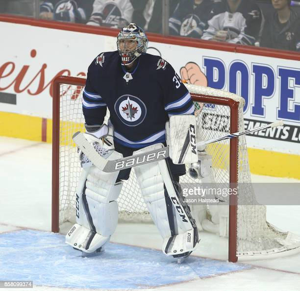Goalie Steve Mason of the Winnipeg Jets follows the play during NHL action against the Toronto Maple Leafs on October 4 2017 at the Bell MTS Place in...