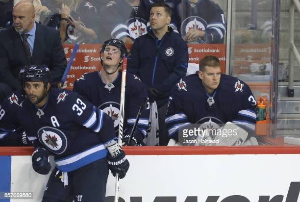 Goalie Steve Mason of the Winnipeg Jets looks to the ice after being pulled during NHL action against the Toronto Maple Leafs on October 4 2017 at...
