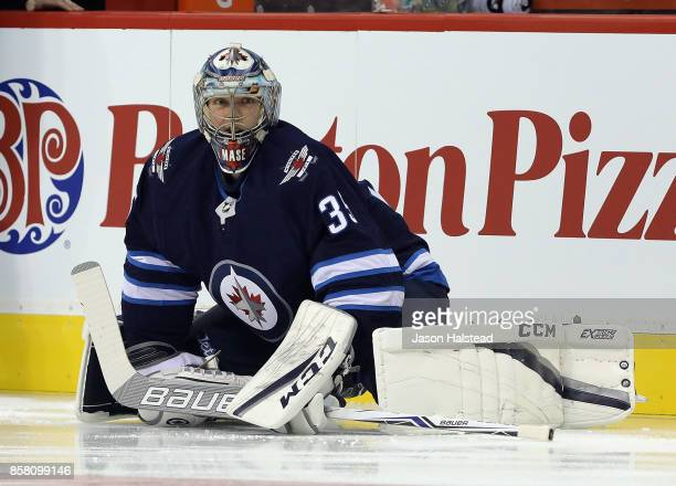 Goalie Steve Mason of the Winnipeg Jets stretches before NHL action against the Toronto Maple Leafs on October 4 2017 at the Bell MTS Place in...