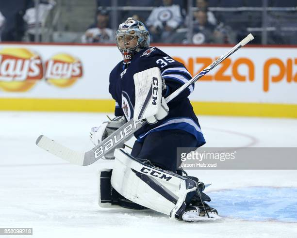 Goalie Steve Mason of the Winnipeg Jets warms up before NHL action against the Toronto Maple Leafs on October 4 2017 at the Bell MTS Place in...