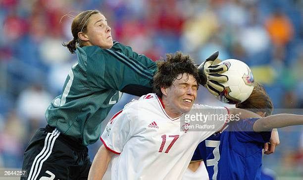 Goalie Taryn Swiatek of Canada catches the ball over her teamamte forward Silvana Burtini during the FIFA Women's World Cup match against Canada at...