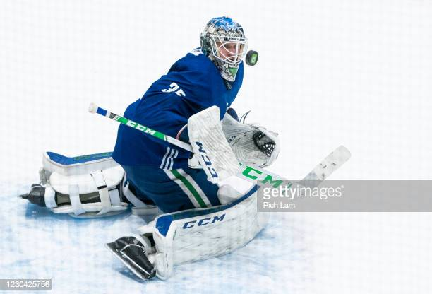 Goalie Thatcher Demko of the Vancouver Canucks makes a save on the first day of the Vancouver Canucks NHL Training Camp on January 2021 at Rogers...