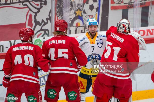 Goalie Tobias Stephan of Lausanne HC fights with David McIntyre of EV Zug during the Swiss National League game between Lausanne HC and EV Zug at...