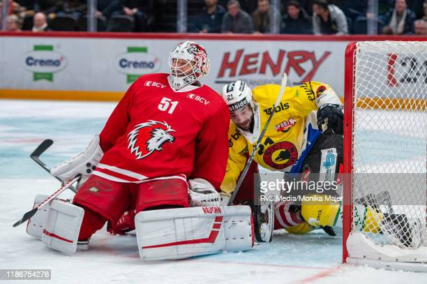 Goalie Tobias Stephan of Lausanne HC makes a save against Simon Moser of SC Bern during the Swiss National League game between Lausanne HC and SC...