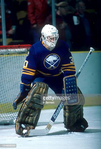 Goalie Tom Barrasso of the Buffalo Sabres looks to make a save during an NHL game circa 1984