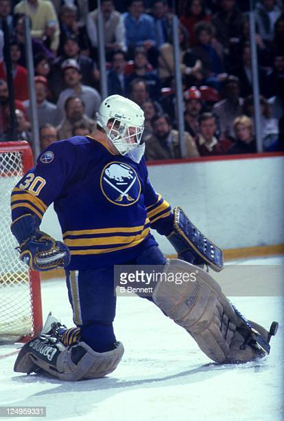 Goalie Tom Barrasso of the Buffalo Sabres makes the kick save during an NHL game against the Philadelphia Flyers circa 1985 at the Spectrum in...