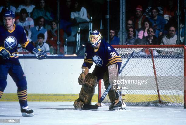 Goalie Tom Barrasso of the Buffalo Sabres makes the save during an NHL game against the New York Islanders on February 14 1987 in Uniondale New York