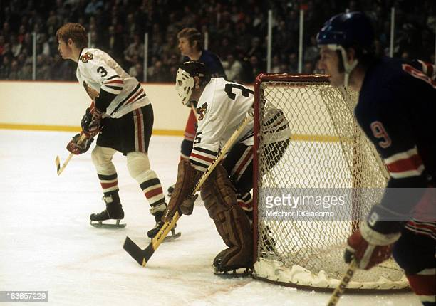 Goalie Tony Esposito and Keith Magnuson of the Chicago Blackhawks defend the net during an NHL game against the New York Rangers circa 1973 at the...
