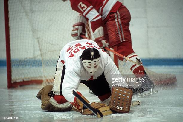 Goalie Tony Esposito of Canada covers the puck against the Soviet Union during the 1972 Summit Series at the Luzhniki Ice Palace in Moscow Russia