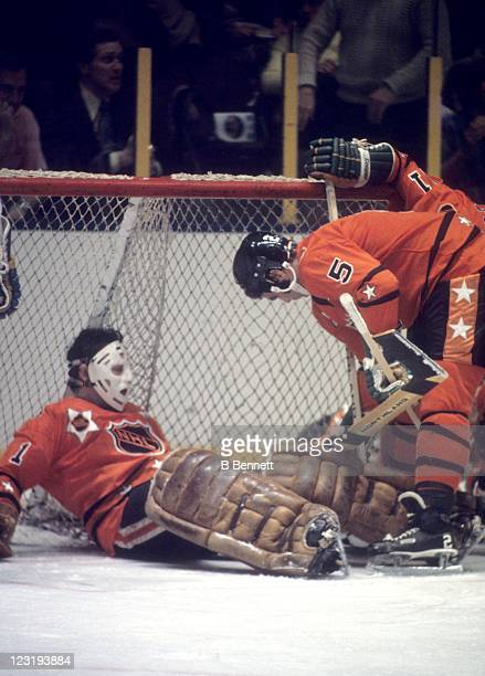 Goalie Tony Esposito of the Chicago Blackhawks and Barry Gibbs of the Minnesota North Stars both from Team West defend the net during the 26th NHL...