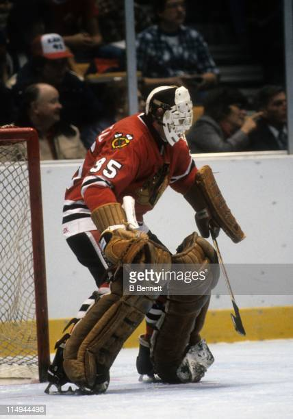 Goalie Tony Esposito of the Chicago Blackhawks defends the net during an NHL game in December 1982