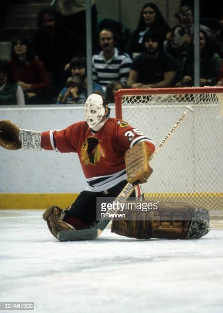 Goalie Tony Esposito of the Chicago Blackhawks defends the net during an NHL game circa 1980