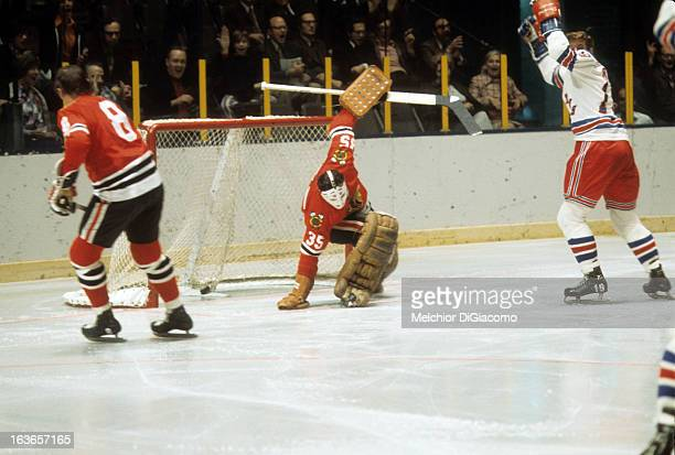 Goalie Tony Esposito of the Chicago Blackhawks is scored on as Jean Ratelle of the New York Rangers celebrates circa 1973 at the Madison Square...