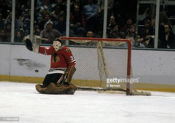 Goalie Tony Esposito of the Chicago Blackhawks looks to make the save during an NHL game circa 1979