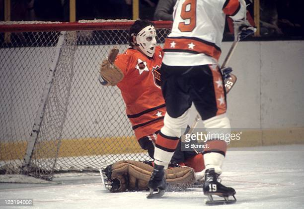 Goalie Tony Esposito of the Chicago Blackhawks looks to make the save on Jean Ratelle of the New York Rangers and Team East during the 26th NHL...