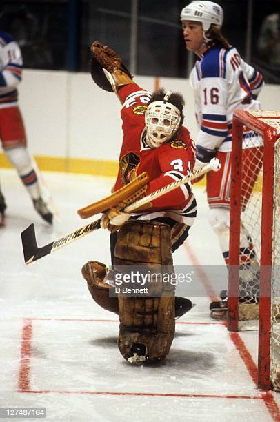 Goalie Tony Esposito of the Chicago Blackhawks looks to make the save during an NHL game against the New York Rangers in 1983 at the Madison Square...
